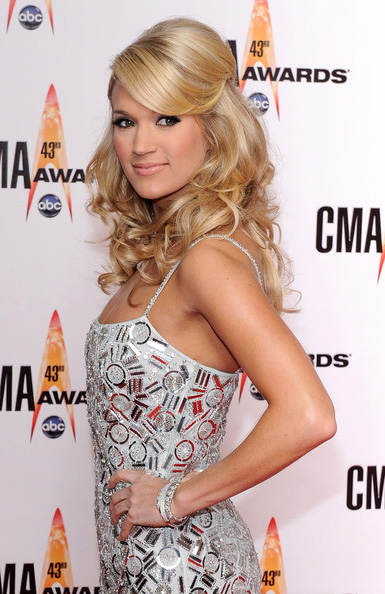carrie underwood hair half up. While Carrie Underwood did a