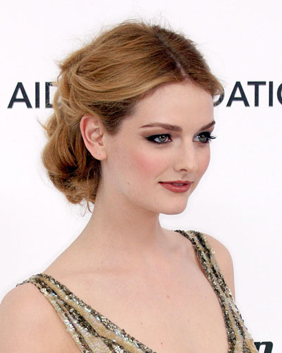 Lydia-Hearst-side-pinned-roll-updo